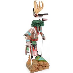 Carved deer Kachina in traditional cottonwood