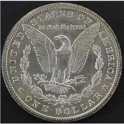 1887 S Morgan silver dollar.
