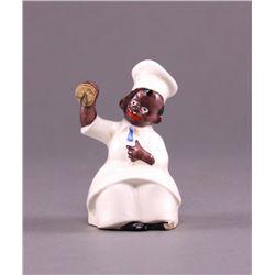Black Americana porcelain figurine.  Small crack in