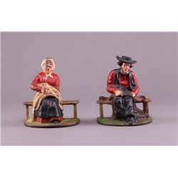 Antique pair of polychrome cast iron Amish figure book