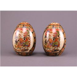 Two Satsuma porcelain eggs, each parcel gilt with