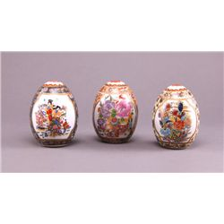 Three Satsuma porcelain eggs, each parcel gilt with