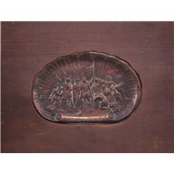 Antique brass plaque depicting the landing of Columbus.