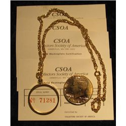1118. Collector's Society of America Gold-plated and Counterstamped Kennedy Half Dollar in a bezel w