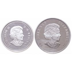 Lot of two (2) ICCS graded commemorative silver coins.