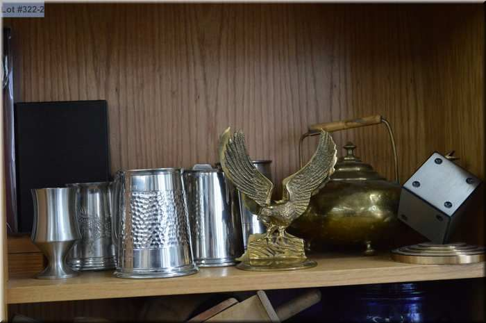 Shelf lot of collectibles including pewter tankards, brass