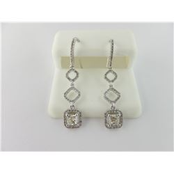 176-17541:14K white gold diamond earrings