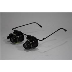 PAIR OF  MAGNIFYING LIGHTED GLASSES