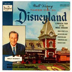 Walt Disney Takes You to Disneyland store display.