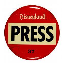 Disneyland press pass badge.