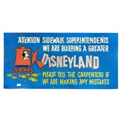 Disneyland under construction billboard.