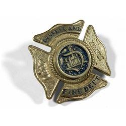 Main Street Fire Department cap badge.