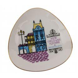 New Orleans Square souvenir plate and cast iron trivet.