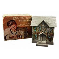 Haunted house tin litho toy.