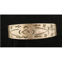 Vintage Cuff with Whirling Log Symbols.