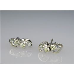 Glittering Fancy Yellow & White Diamond Earrings.