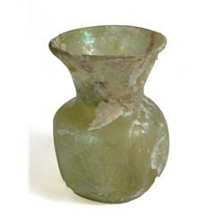 A Roman yellow glass cup