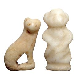 A pair of Egyptian bone amulets