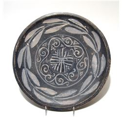 A lovely Greek black-glazed plate