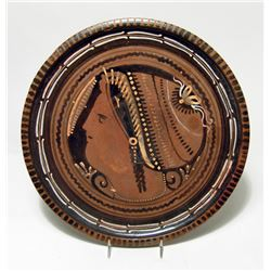 Greek Red-Figure plate featuring head of lady of fashion