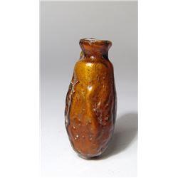 Roman amber mold-blown glass date flask