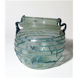 An attractive Roman pale green glass jar