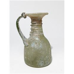 A Roman glass funnel-mouthed jug
