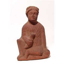 A Cypriot terracotta seated figure