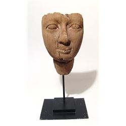 An attractive Egyptian wooden 'mummy' mask