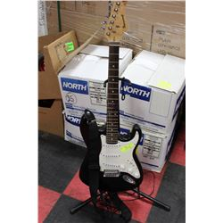 BLACK AND WHITE BURSWOOD GUITAR WITH PATCH CORD,