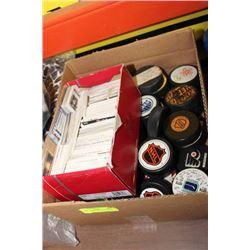BOX W/ VARIOUS HOCKEY PUCKS AND CARDS