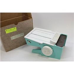 DIAL-O-MATIC FOOD CUTTER