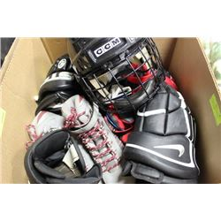 BOX WITH 3 PAIRS ICE SKATES, GLOVES, HELMET