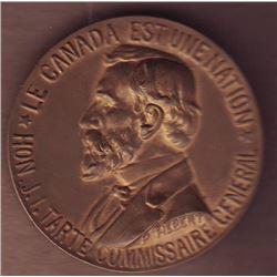 Medal; Le Canada est une Nation - J.L. Tarte Commissaire General, reverse; Exposition International