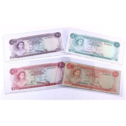 Run of 4 different denominations of 1965 Bahamas banknotes.  $1/2, $1, $3, and $5.  Grades range fro