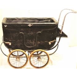 Antique baby buggy with top.