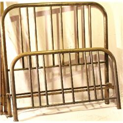 Antique brass bed with rails.