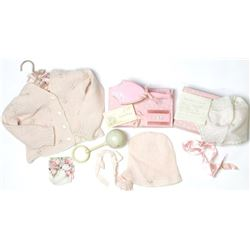 Collection of baby clothes.
