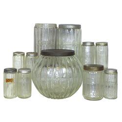 Kitchen cabinet jars (11), Zipper pattern cookie, coffee (1 w/missing lid) & tea jars plus 7 spice j