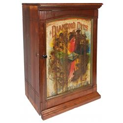 """Country store cabinet, Diamond Dye, """"Evolution of Woman"""", colorful litho on embossed tin front panel"""