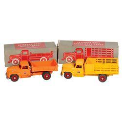 Toy trucks (2), International Stake Body & Dump trucks, mfgd by Product Miniature Co.-Milwaukee, WI,