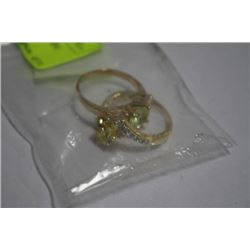 2 GOLD TONE FASHION RINGS IN BAG