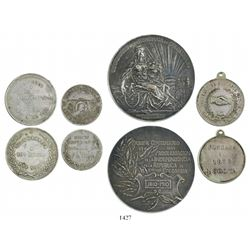 Lot of 4 Colombian silver medals commemorating various events dated 1872, 1900, 1910 and 1919.