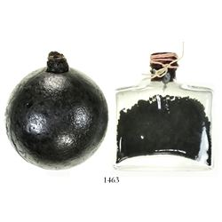 Iron cannonball grenade with original powder intact (rendered inert and housed in a glass bottle) HM