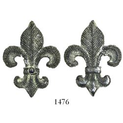 Small, pewter fleur-de-lis ornament with blue stone (sapphire?) in center. 1715 Fleet
