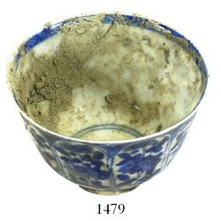 Chinese blue-on-white porcelain teacup, Kangxi period eight-paneled floral design. Spanish 1715 Flee