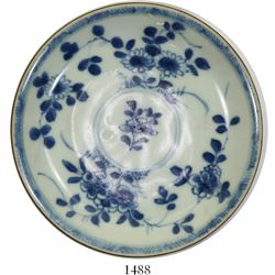 Chinese blue-on-white saucer, Kangxi period, floral design.