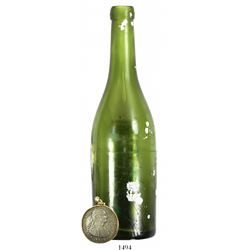 Green-glass bottle and silver coin (Mexico bust 8R 1799FM, mounted in 14K gold pendant-bezel), both