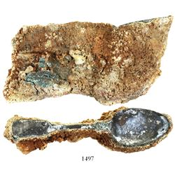 Encrusted clump of 40-50 copper-alloy spoons.