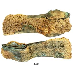Encrusted clump of about 35 copper-alloy spoons.